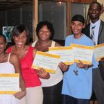 Belize District Team receives their diplomas for completion of their first training.