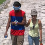 Erroll Longsworth and Liani Castellanos slowly make their way up the pyramids at Caracol.