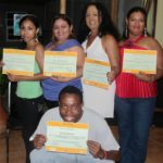 The GOJoven Team from Orange Walk smiles wide at the graduation from the first training