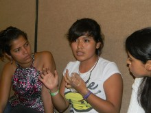 Areli (center) discusses the correct use of the female condom with other GOJoven fellows (click to enlarge)