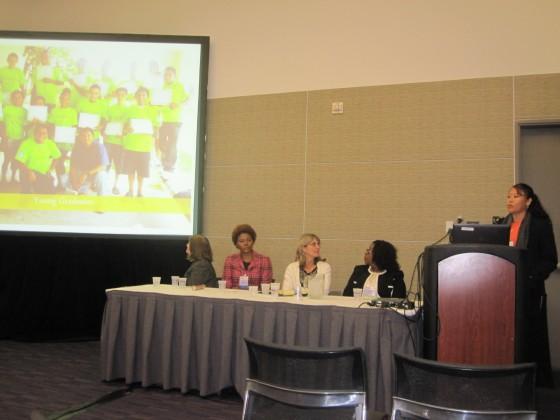 Eva Burgos delivering her presentation to attendees at her session